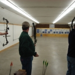 Brian (center) admiring another bullseye